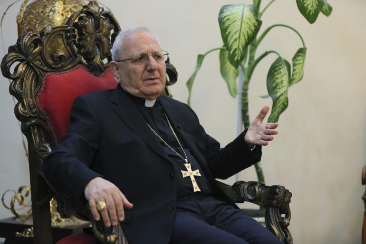 In this Thursday, Dec. 5, 2019 photo, Cardinal Louis Raphael Sako, patriarch of the Chaldean Church, speaks during an interview with The Associated Press in Baghdad, Iraq. Leaders of Iraq's Christians unanimously cancelled Christmas-related celebrations in solidarity with the protest movement - but the aims of their stance go deeper than tinsel and fairy lights. In the slogans calling for a united Iraq, Christians see hope for much needed change from a sectarian system that has long marginalized them. (AP Photo/Khalid Mohammed) (khalid mohammed/ Associated Press)