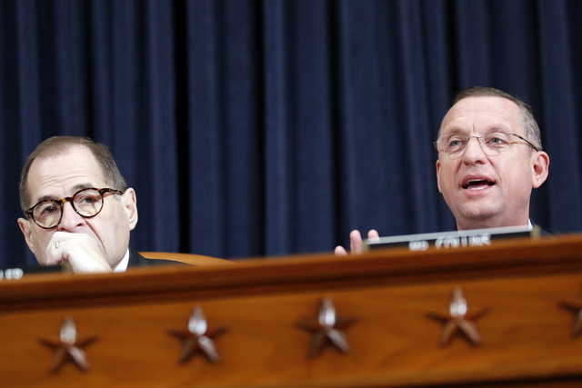 House Judiciary Committee Chairman Rep. Jerrold Nadler, D-N.Y., left, listens as ranking member Rep. Doug Collins, R-Ga., gives and opening statement as the House Judiciary Committee hears investigative findings in the impeachment inquiry of President Donald Trump, Monday, Dec. 9, 2019, on Capitol Hill in Washington. (AP Photo/Alex Brandon)