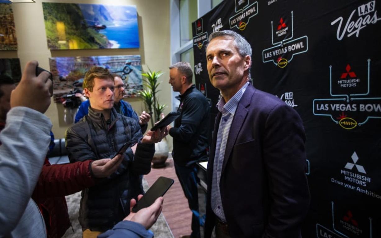 Washington head coach Chris Petersen speaks with reporters ahead of the Las Vegas Bowl NCAA college football game in Las Vegas, Tuesday, Dec. 17, 2019.