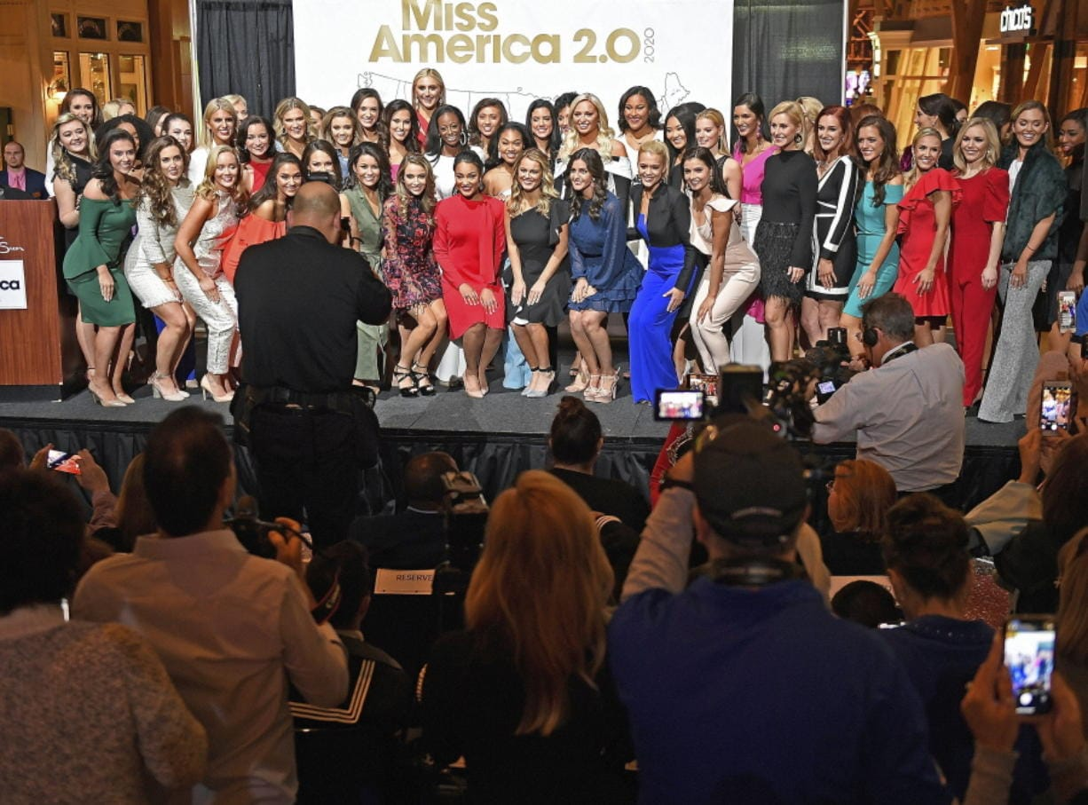 FILE - In this Thursday, Dec. 12, 2019, file photo, candidates for Miss America 2020 pose for a group photo during the official Arrival Ceremony for the Miss America 2.0 competition at Mohegan Sun. Miss America will be crowned for the first time at a tribal casino in Connecticut  on Thursday, Dec. 19, 2019. (Sean D.
