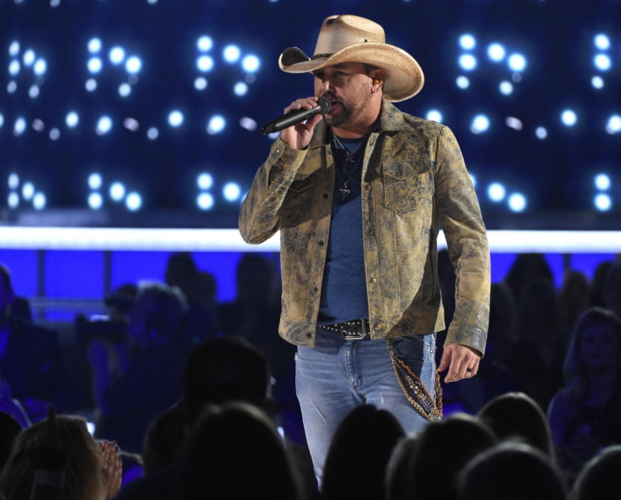 """FILE - This April 7, 2019 file photo shows Jason Aldean performing """"Can't Hide Red"""" at the 54th annual Academy of Country Music Awards in Las Vegas."""