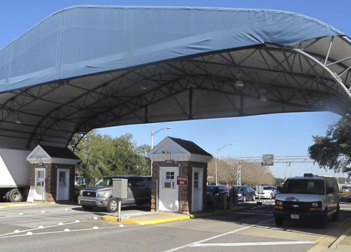 FILE- In this Jan. 29, 2016 file photo shows the entrance to the Naval Air Base Station in Pensacola, Fla. The US Navy is confirming that an active shooter and one other person are dead after gunfire at the Naval Air Station in Pensacola. Area hospital representatives tell The Associated Press that at least 11 people were hospitalized. The base remains locked down amid a huge law enforcement response. (AP Photo/Melissa Nelson, File) (U.S. Navy)