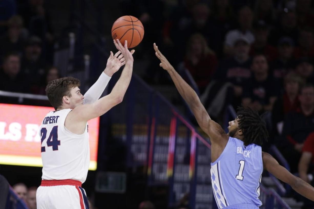 Gonzaga forward Corey Kispert (24) shoots over North Carolina guard Leaky Black (1) during the first half of an NCAA college basketball game in Spokane, Wash., Wednesday, Dec. 18, 2019.