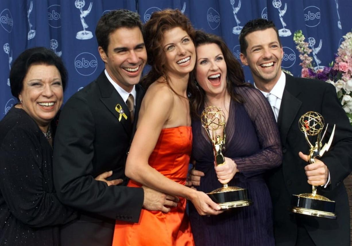 "FILE - In this Sept. 10, 2000, file photo, Shelley Morrison, from left, Eric McCormack, Debra Messing, Megan Mullally and Sean Hayes celebrate their awards for their work in ""Will & Grace"" at the 52nd annual Primetime Emmy Awards in Los Angeles. Morrison, an actress with a 50-year career who was best known for playing a memorable maid on ""Will and Grace,"" has died. Publicist Lori DeWaal says Morrison died Sunday, Dec. 1, 2019, at Cedars-Sinai Medical Center in Los Angeles from heart failure. She was 83."
