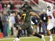 Oregon running back CJ Verdell (7) rushes for a touchdown past Utah defensive back Javelin Guidry (28) during the second half of an NCAA college football game for the Pac-12 Conference championship in Santa Clara, Calif., Friday, Dec. 6, 2018. Oregon won 37-15.
