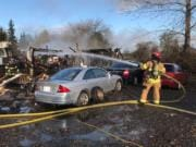 A fire in Ridgefield on Monday morning destroyed an RV trailer and damaged a boat, motorhome and cars, according to Clark County Fire & Rescue. A total of 12 responders helped extinguish the blaze.