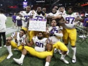 LSU players celebrate after the Southeastern Conference championship NCAA college football game against Georgia, Saturday, Dec. 7, 2019, in Atlanta. LSU won 37-10.