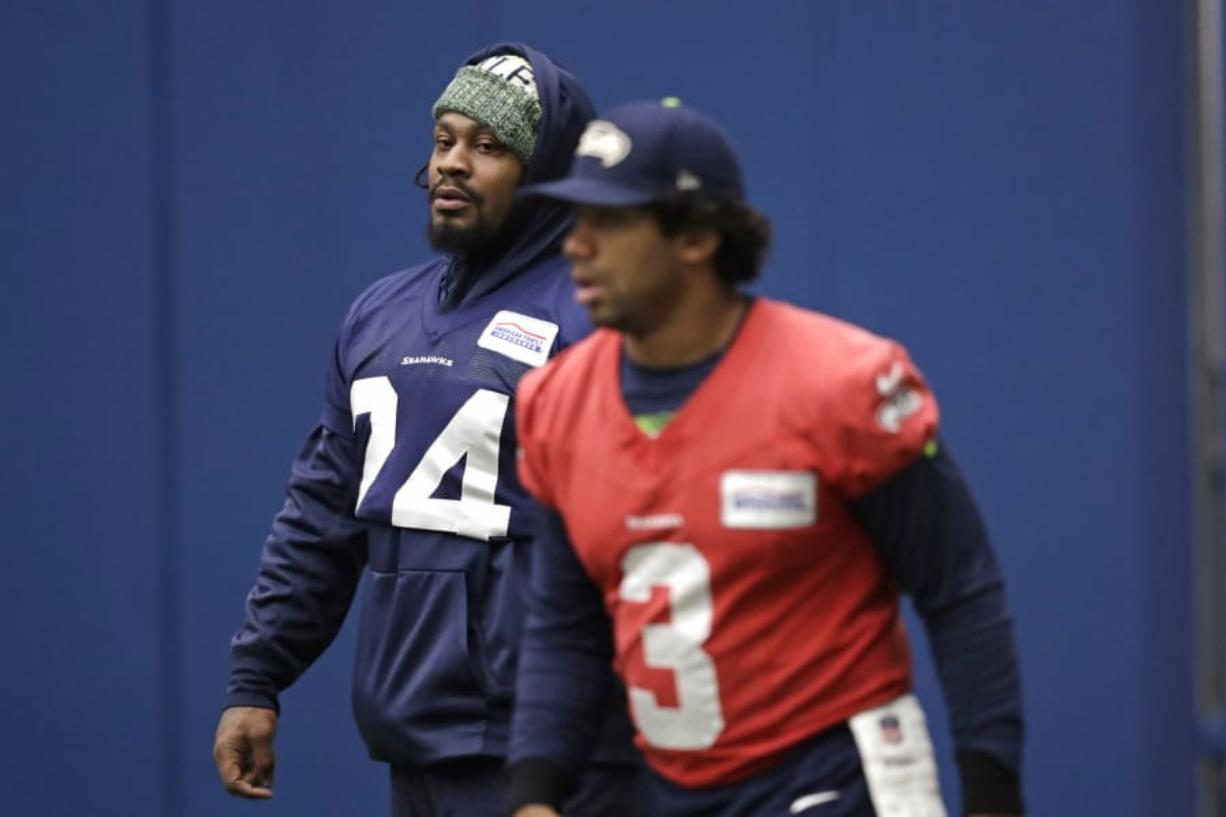 The return of running back Marshawn Lynch, left, has given the injury-riddled Seattle Seahawks a boost of energy. (Elaine Thompson/Associated Press)