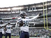 Seattle Seahawks' Bradley McDougald (30) celebrates after intercepting a Philadelphia Eagles' pass during the first half of an NFL football game, Sunday, Nov. 24, 2019, in Philadelphia.