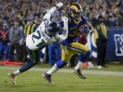 Los Angeles Rams running back Todd Gurley, right, scores past Seattle Seahawks cornerback Tre Flowers during the second half of an NFL football game Sunday, Dec. 8, 2019, in Los Angeles.