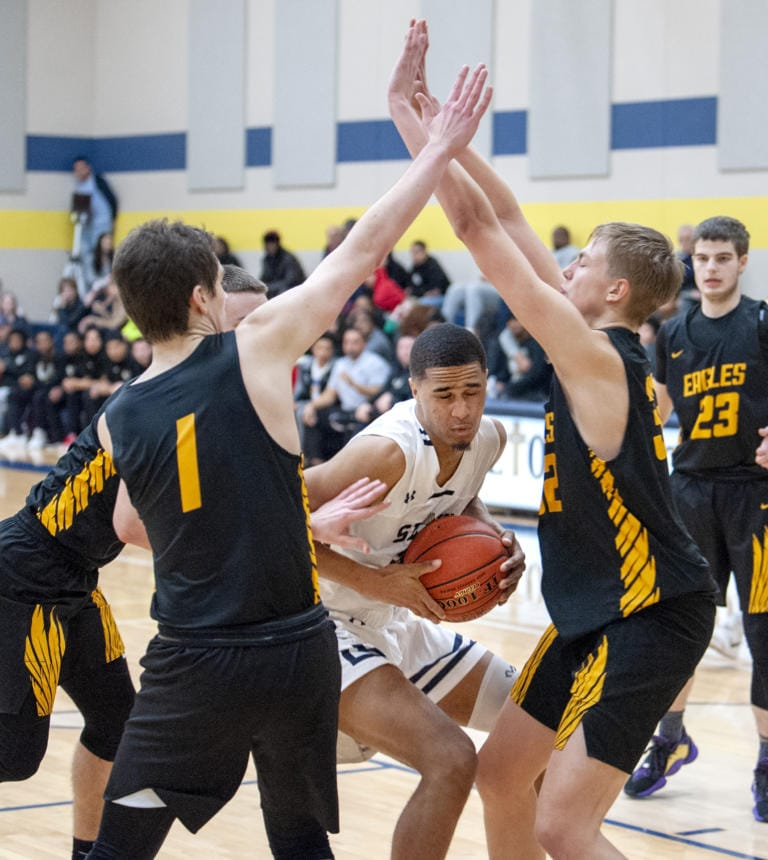 Images from Hudson Bay's 54-53 win over Seton Catholic in a non-league boys basketball game Thursday at Seton Catholic School. (Joshua Hart/The Columbian)