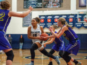 Skyview's Kazz Parks drives through the Columbia River defense.