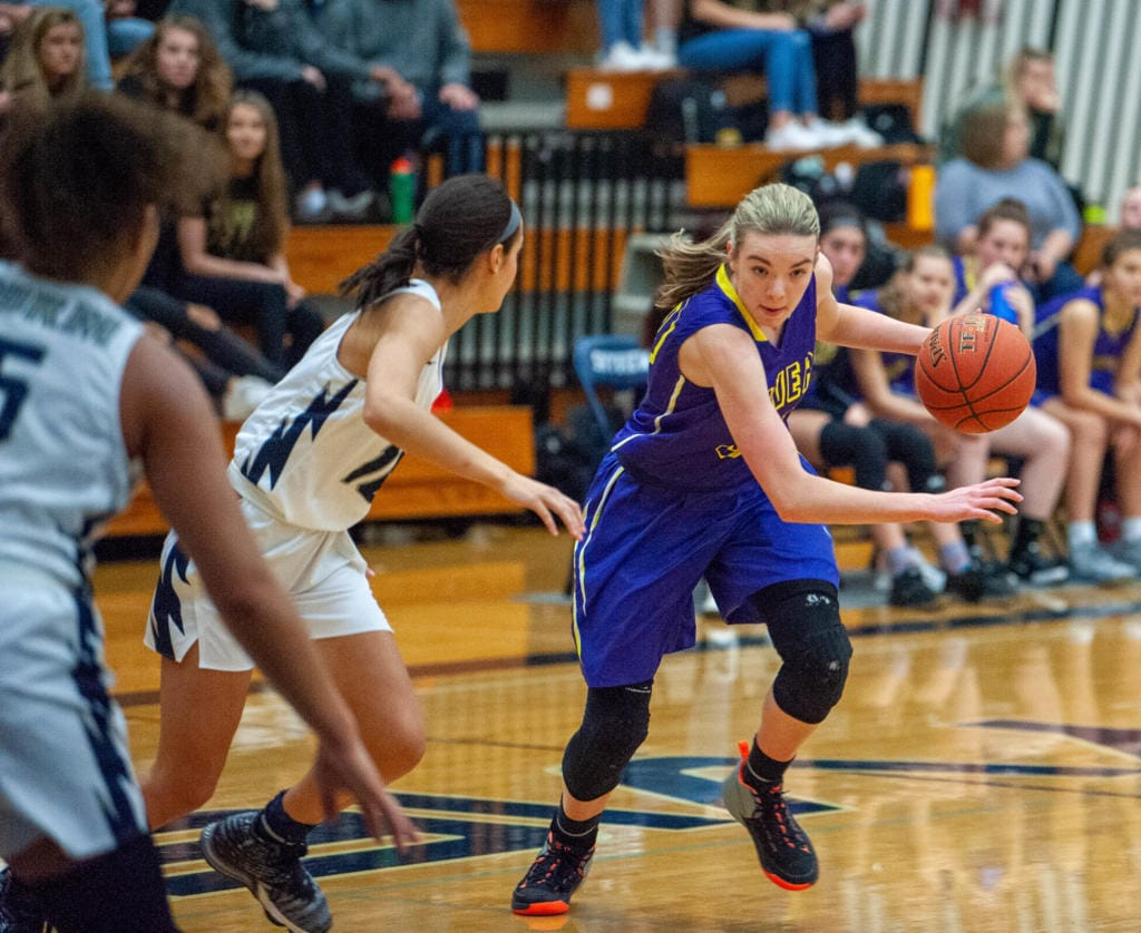 Columbia River's Jordan Ryan drives against Skyview's Ava Harman.