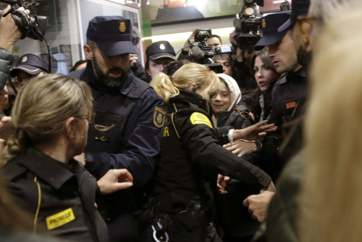 Climate activist Greta Thunberg arrives by train in Madrid on Friday Dec. 6, 2019. Thunberg arrived by catamaran in Lisbon after a three-week voyage across the Atlantic Ocean from the United States before heading to neighboring Spain to attend the U.N. Climate Change Conference taking place in Madrid. (AP Photo/Andrea Comas)