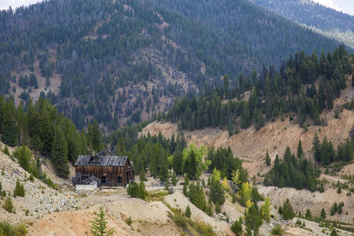 This Sept. 19, 2018 photo shows the last standing building above the Yellow Pine Pit open-pit gold mine in the Stibnite Mining District in central Idaho, where a company hopes to start mining again. Documents show the Trump administration intervening in a U.S. Forest Service decision so that a Canadian company could write a key environmental report on its proposed open-pit gold mines in central Idaho. (Riley Bunch/Idaho Press-Tribune via AP) (Riley Bunch/Idaho Press-Tribune)