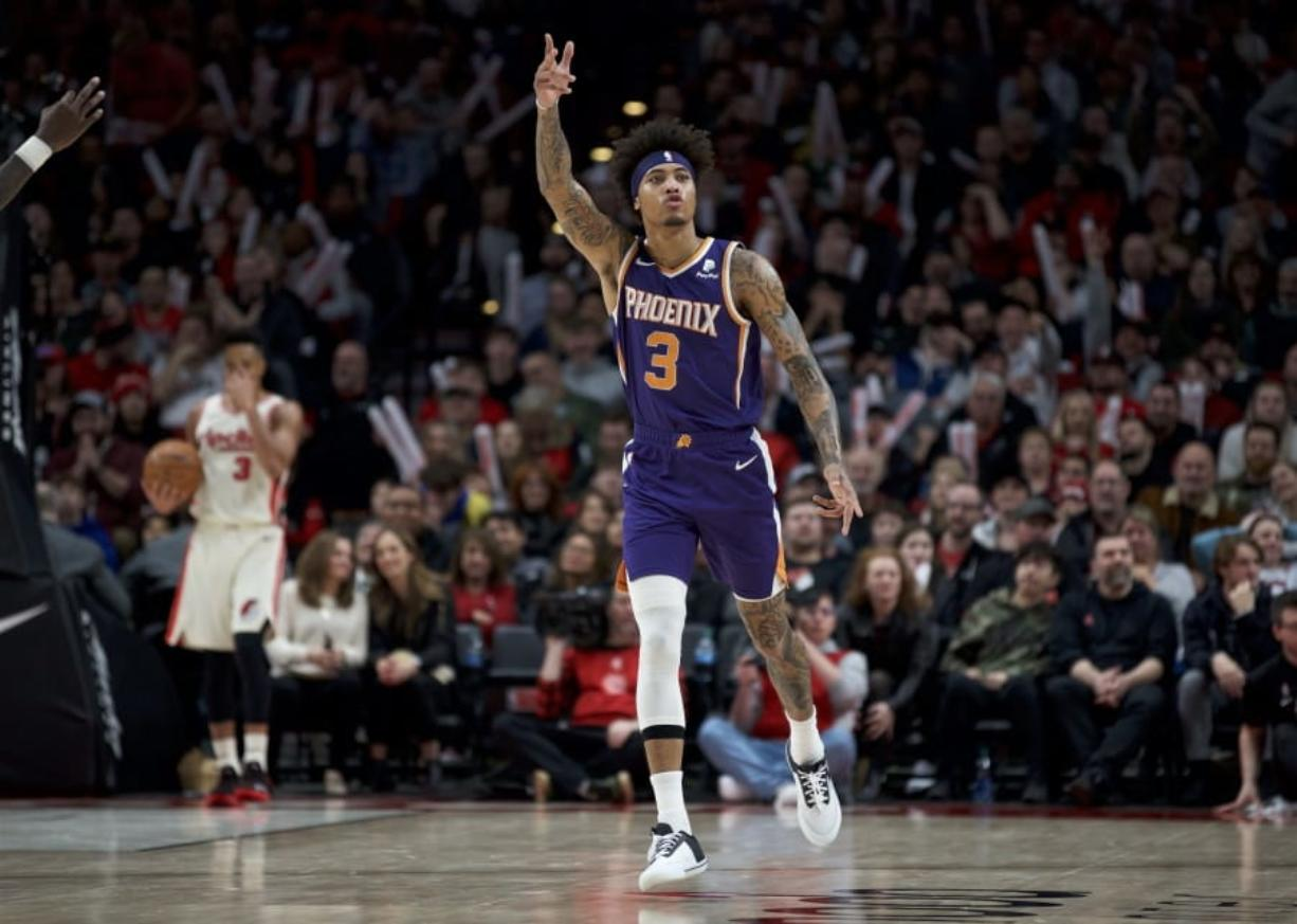 Phoenix Suns forward Kelly Oubre Jr. reacts after making a 3-point basket against the Portland Trail Blazers during the second half of an NBA basketball game in Portland, Ore., Monday, Dec. 30, 2019. The Suns won 122-116.