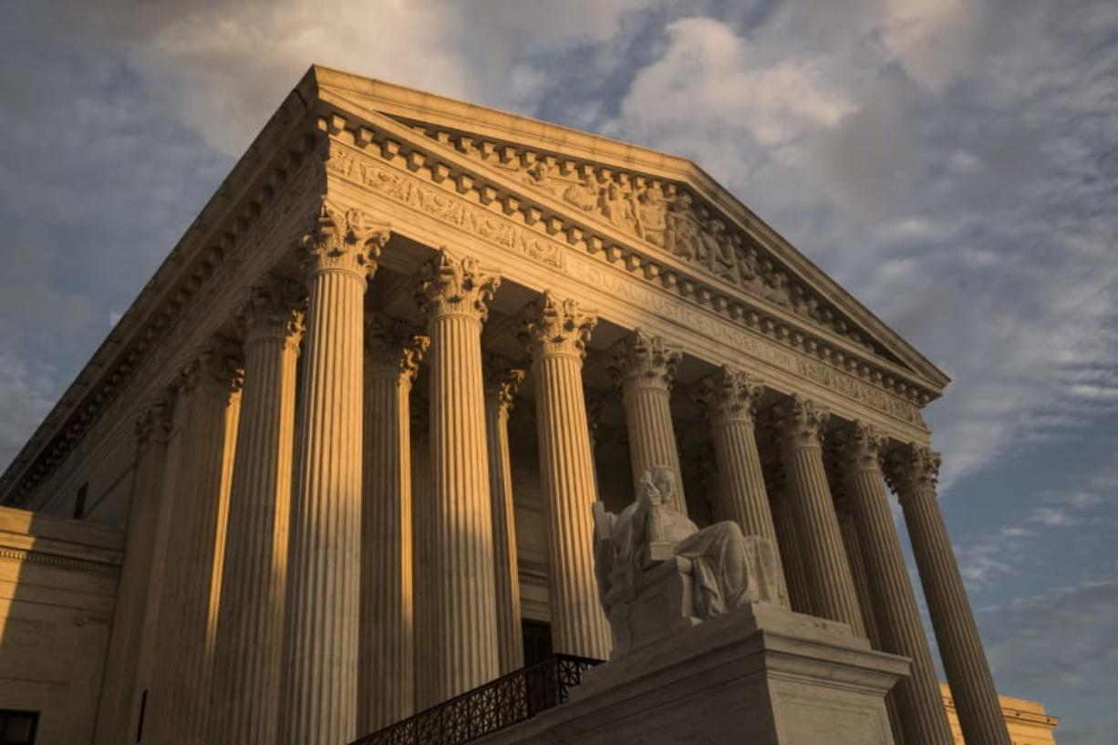 FILE - In this Oct. 10, 2017, file photo, the Supreme Court in Washington, at sunset. The Supreme Court is turning to gun rights for the first time in nearly a decade, even though New York City gun owners already have won changes to a regulation they challenged in court. (AP Photo/J. Scott Applewhite, File)
