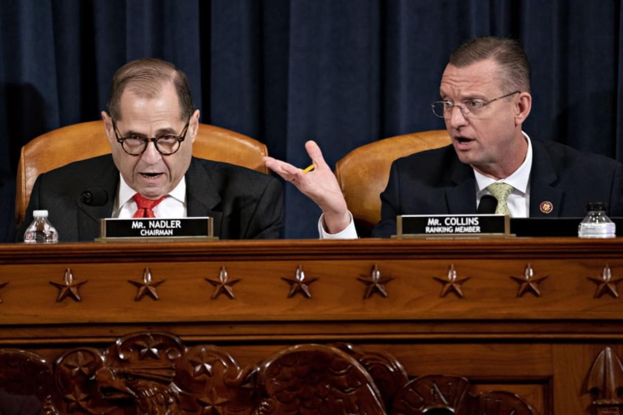 House Judiciary Committee Chairman Rep. Jerrold Nadler, D-N.Y., left, and ranking member Rep. Doug Collins, R-Ga., right,  both speaking during a House Judiciary Committee markup of the articles of impeachment against President Donald Trump, on Capitol Hill Thursday, Dec. 12, 2019, in Washington.