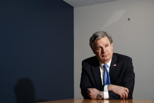 "FBI Director Christopher Wray listens during an interview with The Associated Press, Monday, Dec. 9, 2019, in Washington. Wray says the problems found by the Justice Department watchdog examining the origins of the Russia probe are ""unacceptable."" (AP Photo/Jacquelyn Martin)"