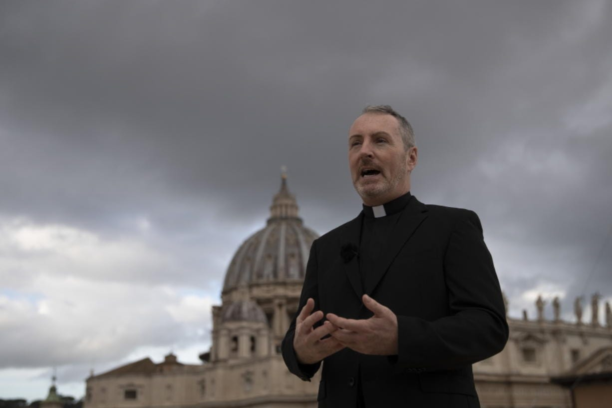 """In this Monday, Dec. 9, 2019 photo, Monsignor John Kennedy, the head of the Congregation for the Doctrine of the Faith discipline section, speaks during an interview on the terrace of the section's offices at the Vatican. """"We're effectively seeing a tsunami of cases at the moment, particularly from countries where we never heard from (before),"""" Kennedy said, referring to allegations of abuse that occurred for the most part years or decades ago. (AP Photo/Alessandra Tarantino)"""