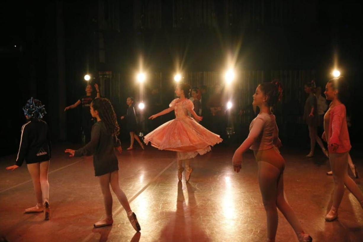 """Young dancers perform on stage during a rehearsal of Vladimir Issaev's rendition of The Nutcracker ballet on Friday, Dec. 13, 2019, in Fort Lauderdale, Fla. More than 20 dancers of Venezuelan origin were playing various roles on a recent performance of the holiday favorite """"The Nutcracker."""" Some of these dancers are here seeking asylum after fleeing their crisis-torn nation, which is plagued by shortages of food and medicine."""