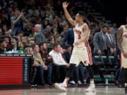 Portland Trail Blazers guard CJ McCollum hypes up the crowd after scoring against Golden State during the second half Wednesday in Portland. The Blazers won 122-112.