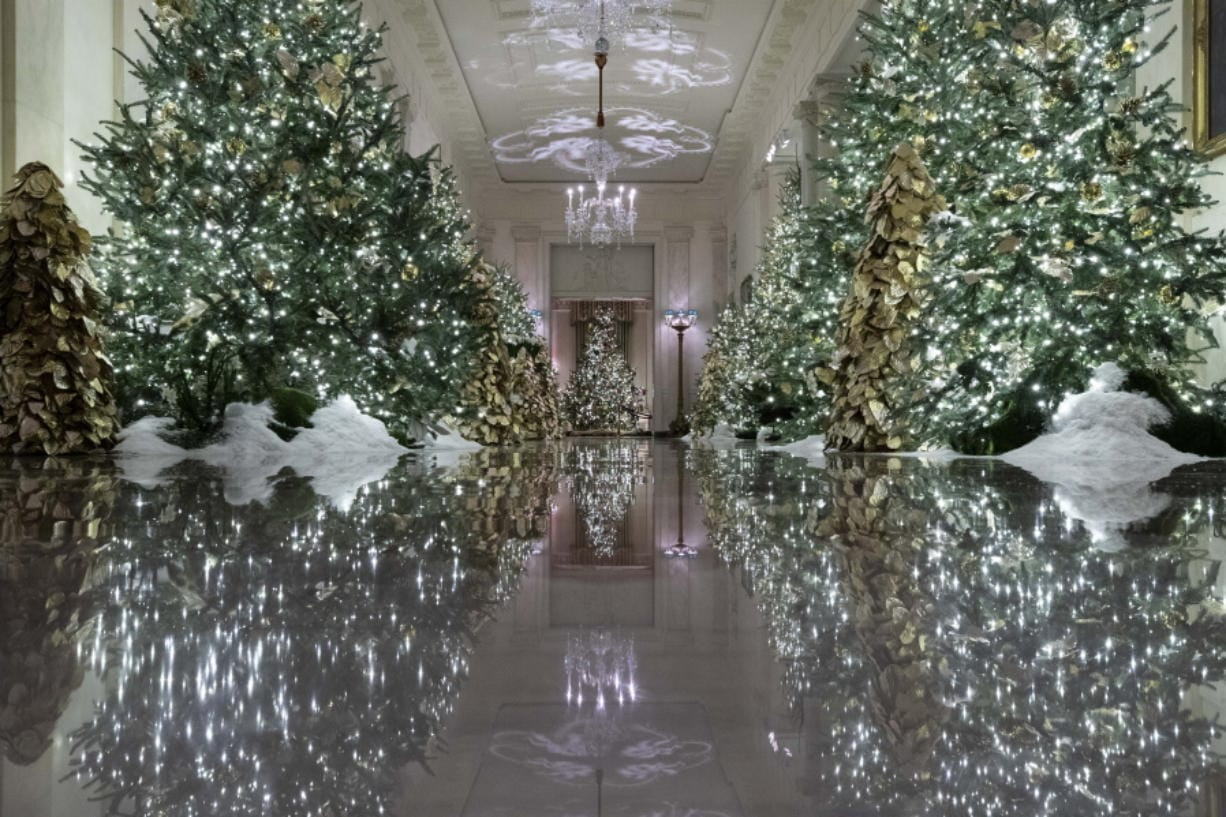 The Cross Hall leading into the State Dinning Room is decorated Monday during the 2019 Christmas preview at the White House in Washington.
