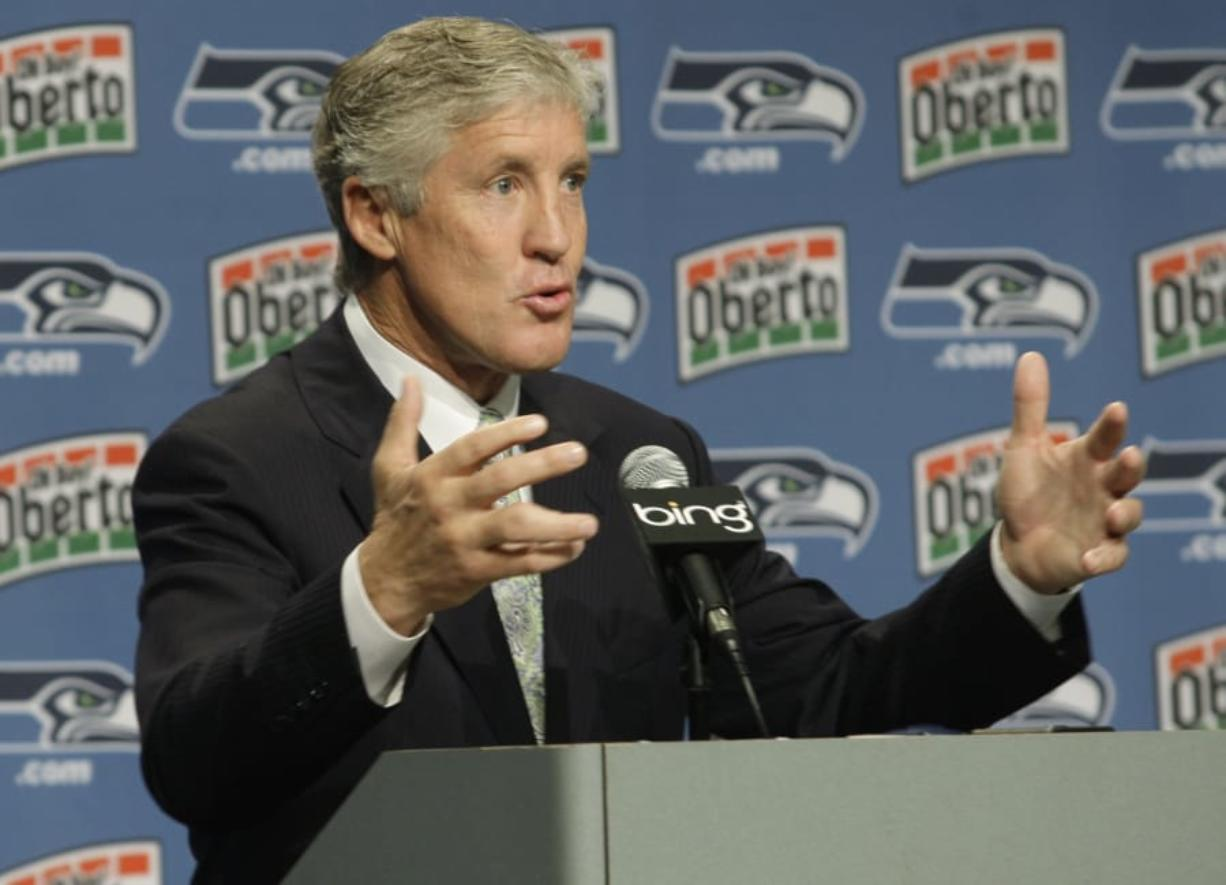 Pete Carroll was animated and energetic during his first press conference as head coach and executive vice president of the Seattle Seahawks on Jan. 12, 2010. (Ted S. Warren/The Associated Press)