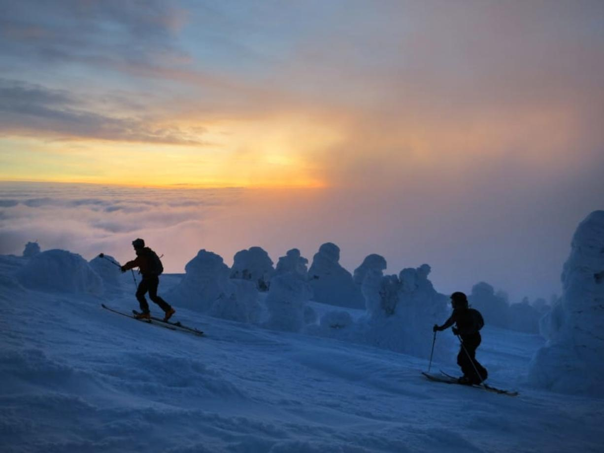 Jeff Zickler and Daniel Henry ascend to the summit of Mount Spokane at dawn Jan. 15, 2013, in Spokane. (The Spokesman-Review files)