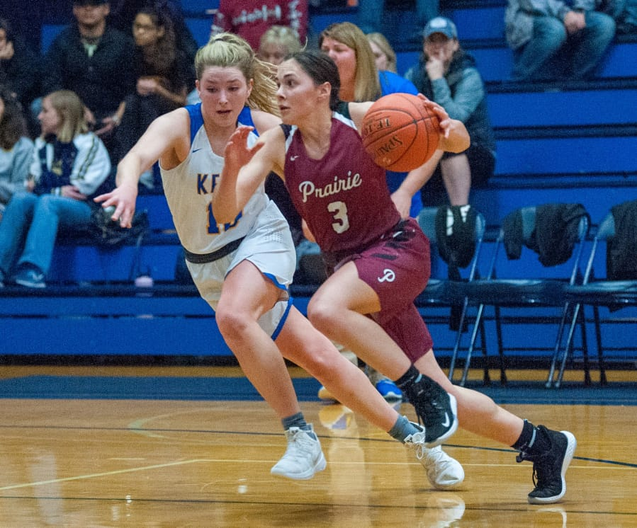 Prairie's Meri Dunford drives past Kelso's Cooper Joy in a 44-29 3A Greater St. Helens Leauge victory on Thursday. Dunford led the Falcons with 10 points.