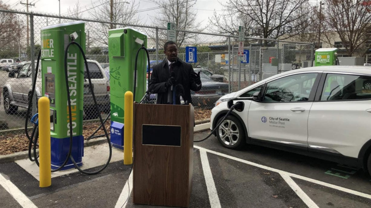 Emeka Anyanwu, energy innovation and resources officer for Seattle City Light, speaks at an event unveiling the utility's new electric vehicle charging stations in the city's SoDo neighborhood.