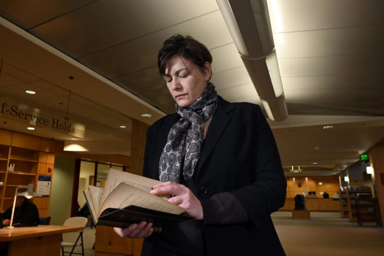 """Gabrielle Dean, a curator for rare books and manuscripts at Johns Hopkins University, holds the lost sixth copy of a """"A Problem in Greek Ethics"""" by John Addington Symonds. Dean found the copy of the privately printed book."""