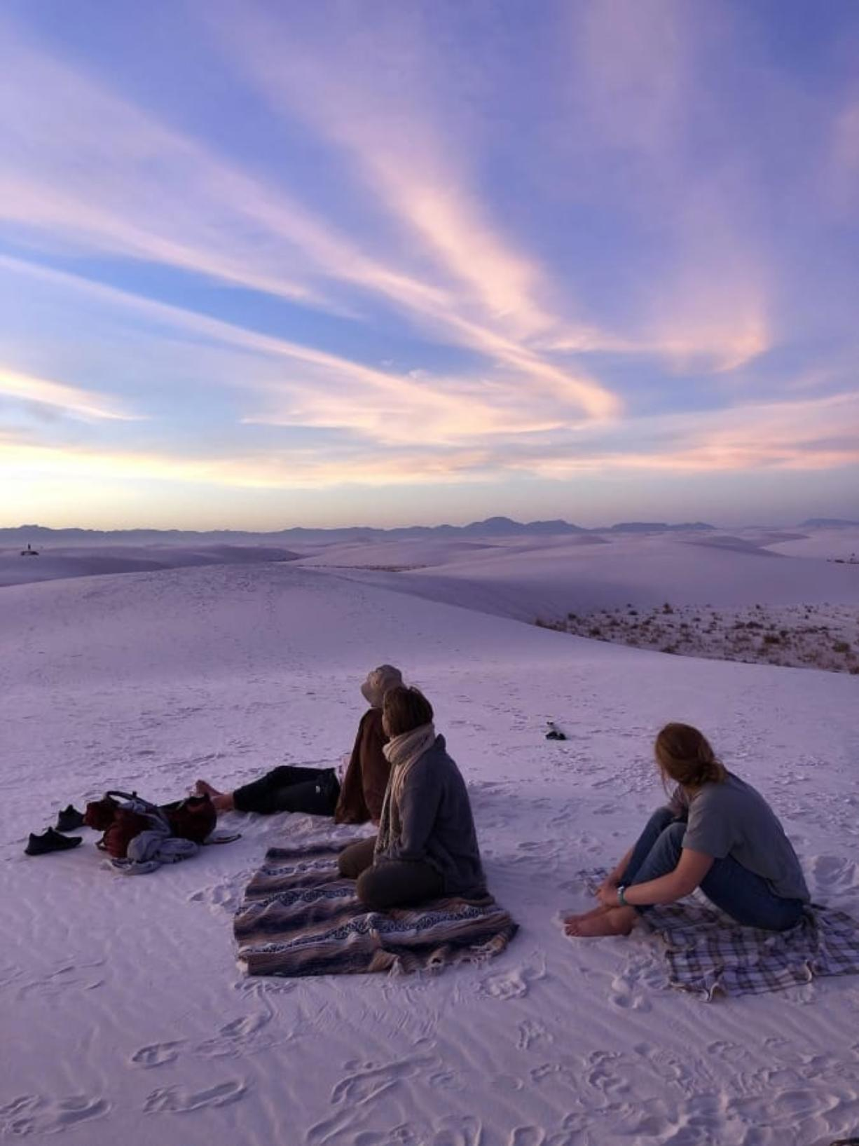 Campers catch the sunset on top of the dunes in White Sands National Park in New Mexico. (Photos by Melanie Radzicki McManus/Chicago Tribune)