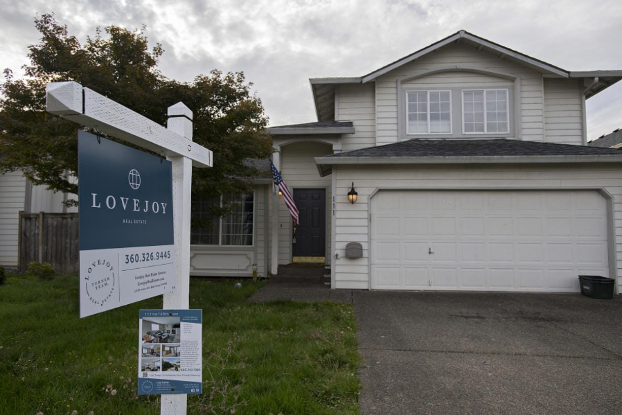 A sign notifies those passing by of a home for sale in Salmon Creek in October. (Amanda Cowan/The Columbian)