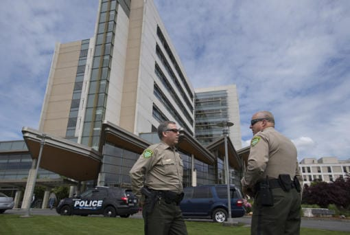 Clark County Undersheriff Mike Cooke, left, talks with Chief Criminal Deputy John Chapman during a 2017 incident at PeaceHealth Southwest Medical Center. Cooke is retiring, and Chapman will take his place as undersheriff. (Amanda Cowan/The Columbian)