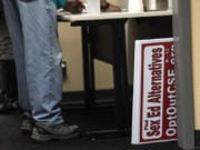 Signs calling for opposition to proposed sex education curriculum are seen here after being confiscated from a community member during a Battle Ground Public Schools Board of Directors meeting on Monday night, Oct. 14, 2019.