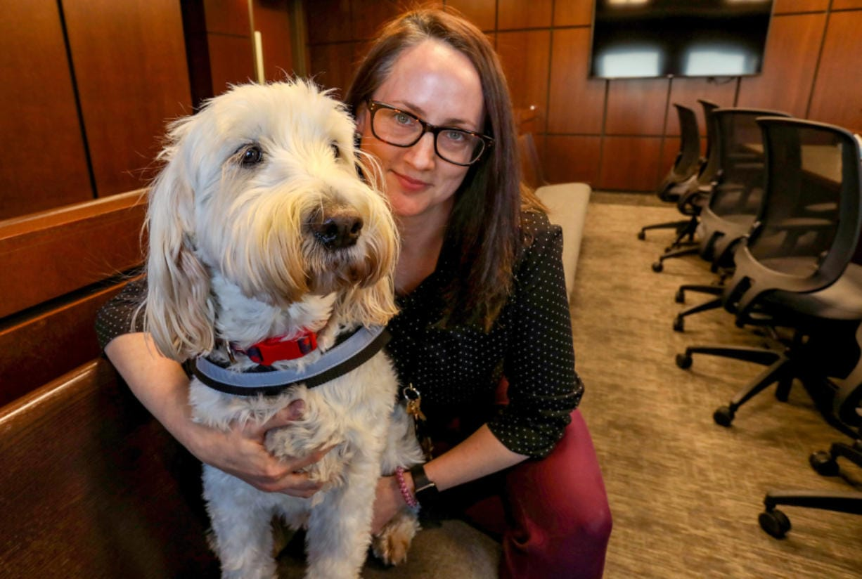 Izzy with Amy Mitchell, a casework supervisor and Izzy's handler at the Macomb County Juvenile Court in downtown Mt. Clemens on Thursday, Dec. 29, 2019.