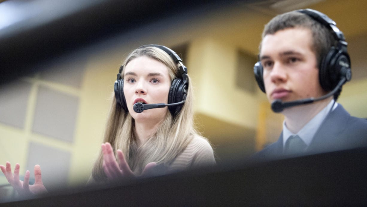 Columbia River senior Jordan Ryan provides the color commentary for VPS Game Time during a boys basketball game on Friday at Hudson's Bay High School.