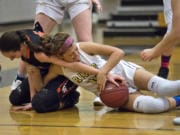 Skylar Bea, left, and her Washougal teammates always seem to get a hand on the ball. The Panthers' disruptive defense has been a key to the team's success this season.