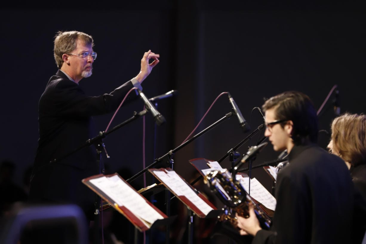 Doug Harris, music instructor and director of Clark College's annual jazz festival, conducts last year's Clark College Jazz Ensemble. (The Columbian files)