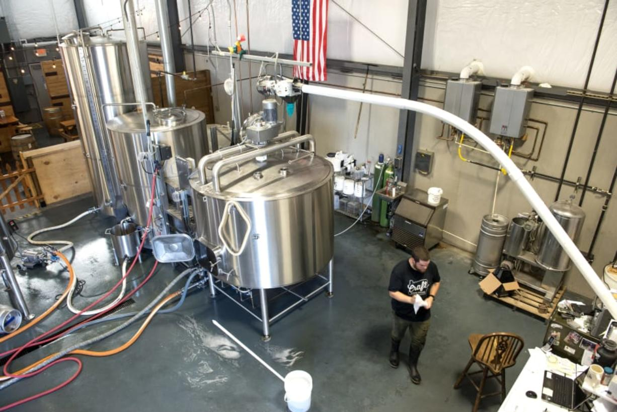 Brewer John Bitter walks through 54-40 Brewing of Washougal in 2018.