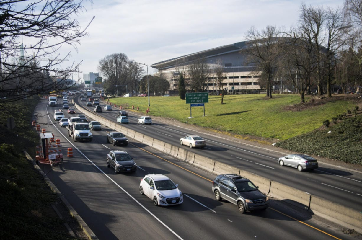 Morning traffic moves along Interstate 5 near the Moda Center in Portland, a congested section of the freeway with only two through freeway lanes that experiences 3.5 times more crashes than Oregon's statewide average. (Alisha Jucevic/Columbian files)
