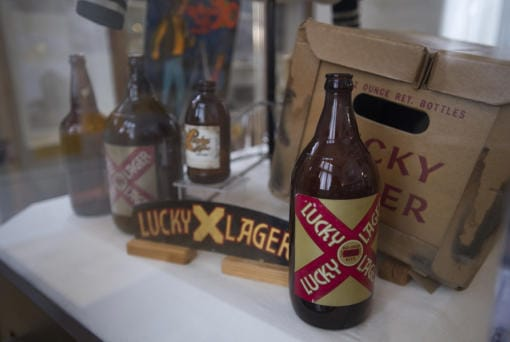 """Lucky Lager beer bottles from the 1940s-1980s are seen on display at the new """"History A-Brewin' """" exhibit on Friday afternoon. (Amanda Cowan/The Columbian)"""