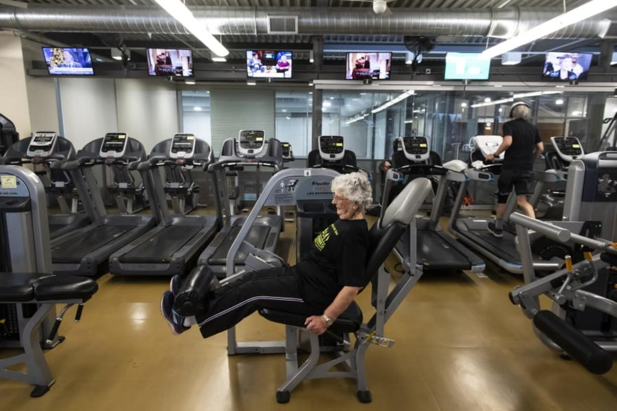 Olga Vilen, 90, works out at Firstenburg Community Center in Vancouver. Vilen took up exercise about 20 years ago, and it has become a source of consistent good in her life, as well as her husband Dale's life. (Photos by Nathan Howard/The Columbian)