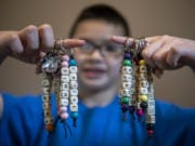 Keoni has sold more than 100 keychains to help raise money for unpaid school lunch debt his school.