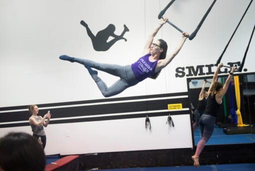 Brittany Ashworth, owner of Premier Cirque in Hazel Dell, swings during a Saturday trapeze class. She founded the business because she was tired of commuting to classes in Portland. (Samuel Wilson for The Columbian)
