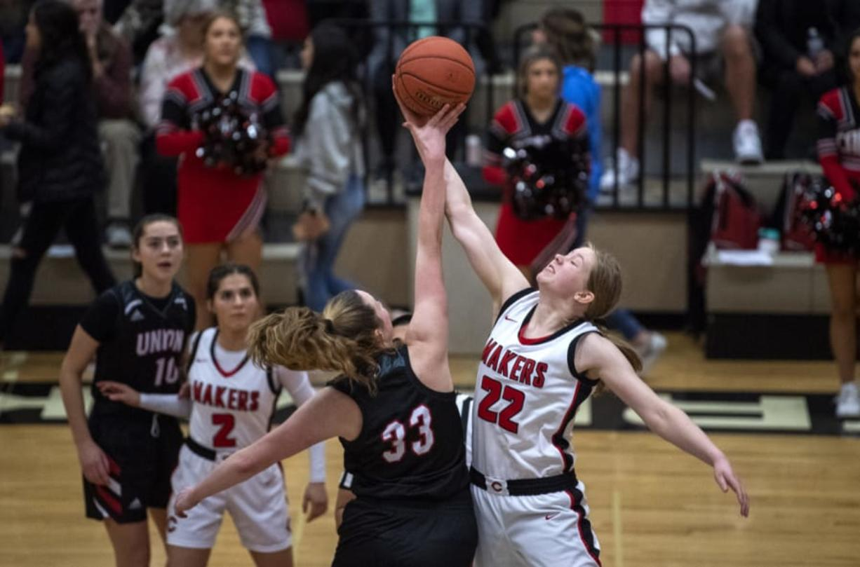Union's Sarah Litchford (33) and Camas' Faith Bergstrom (22) tipoff at the start of Tuesday night's game at Camas High School in Camas on Jan. 7, 2020. Camas won 52-44.