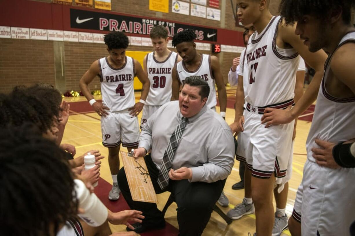 Prairie coach Jimmy Tuominen talks with his team during Friday night's game at Prairie High School in Vancouver on Jan. 10, 2020. Prairie won 44-32.