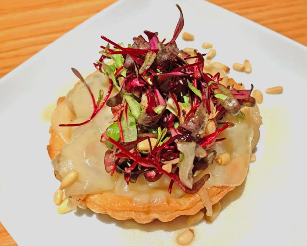 Onion tart at Roots Restaurant & Bar in Camas is topped with Bulls Blood Beet microgreens. (Rick Browne)