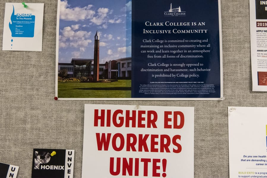 A poster signalling support for the Association for Higher Education hangs in a hallway of faculty offices in Foster Hall at Clark College on Monday afternoon. Faculty are poised to strike Jan. 13 if a deal is not reached between the union and college administration. (Nathan Howard/The Columbian)